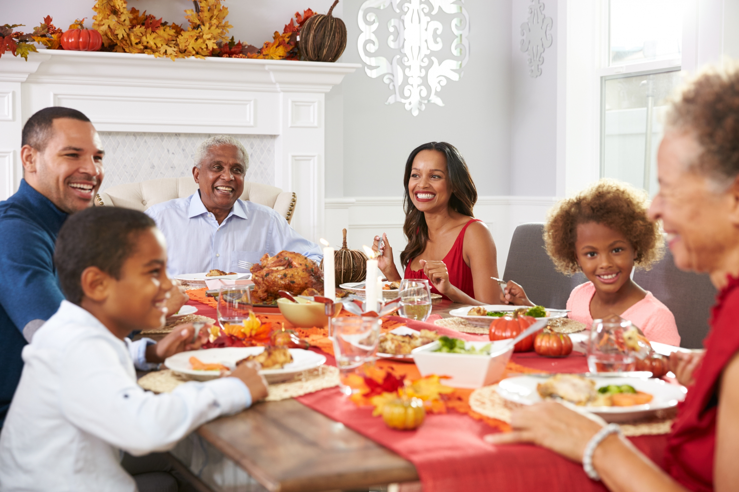 Family Celebrating the Holidays Over a Meal